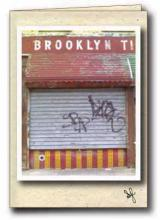 Brooklyn Tile storefront with graffiti